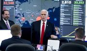 A large monitor displaying a map of Asia and a tally of total coronavirus cases, deaths, and recovered, is visible behind Vice President Mike Pence, center, and Health and Human Services Secretary Alex Azar, left, as they tour the Secretary's Operations Center following a coronavirus task force meeting at the Department of Health and Human Services, Thursday, Feb. 27, 2020, in Washington. (AP Photo/Andrew Harnik)