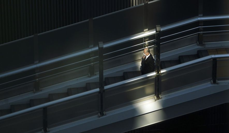 A man with a protective mask walks on a pedestrian bridge Thursday, Feb. 27, 2020, in Tokyo. At a government task force meeting Wednesday on the virus outbreak, Prime Minister Shinzo Abe said he was asking organizers to cancel or postpone major sports or cultural events over the next two weeks. (AP Photo/Eugene Hoshiko)