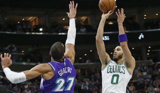 Boston Celtics forward Jayson Tatum (0) shoots as Utah Jazz center Rudy Gobert (27) defends during the second half during an NBA basketball game Wednesday, Feb. 26, 2020, in Salt Lake City. (AP Photo/Rick Bowmer)