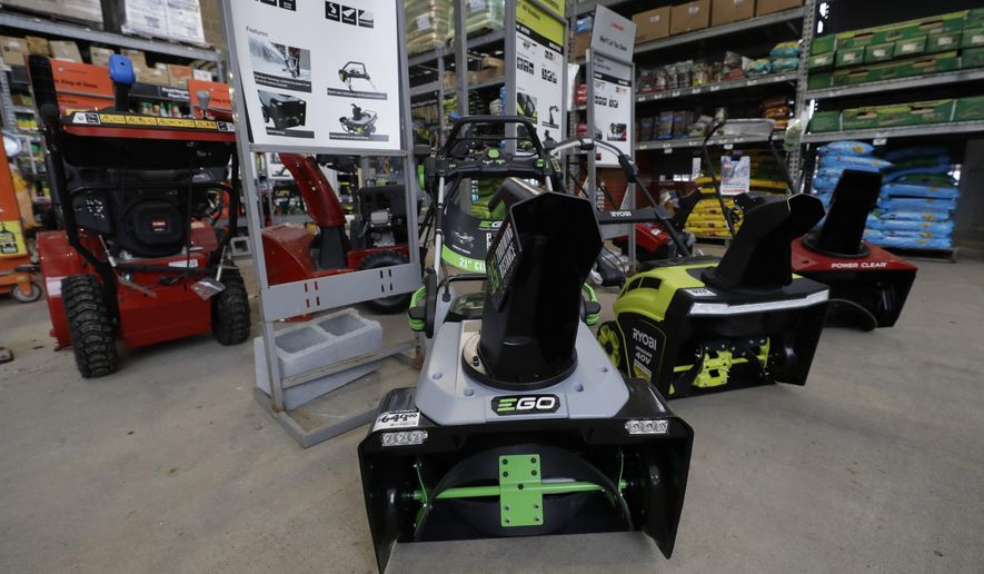 In this Jan. 27, 2020 photo snow blowers are lined up at a Home Depot store location in Boston. On Thursday, Feb. 27, the Commerce Department releases its January report on durable goods. (AP Photo/Steven Senne)