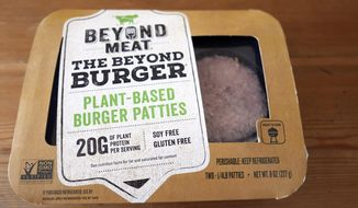In this June 26, 2019, file photo, a package of meatless burgers are seen in Orlando, Fla. Beyond Meat reports earnings Thursday, Feb. 27. (AP Photo/John Raoux, File) **FILE**