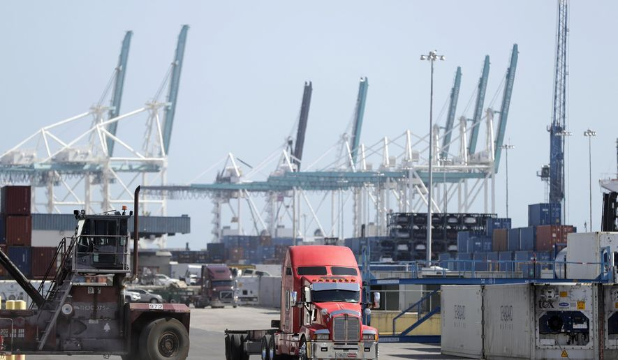 In this Friday, Feb. 14, 2020 photo, a truck leaves the docks at PortMiami in Miami. On Thursday, Feb. 27, the Commerce Department issues the second estimate of how the U.S. economy performed in the fourth quarter. (AP Photo/Wilfredo Lee)