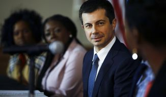 Democratic presidential candidate former South Bend, Ind., Mayor Pete Buttigieg listens during a roundtable discussing health equity, Thursday, Feb. 27, 2020, at the Nicholtown Missionary Baptist Church in Greenville, S.C. (AP Photo/Matt Rourke)