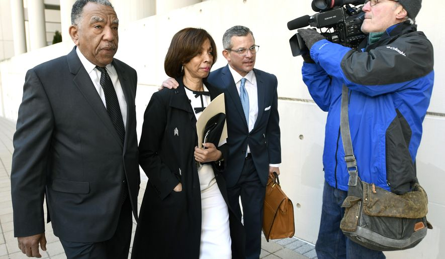 Former Baltimore mayor Catherine Pugh, second from left, and her attorney Steven Silverman, third from left, arrive for a sentencing hearing at U.S. District Court in Baltimore on Thursday, Feb. 27, 2020. Pugh pleaded guilty in 2019 to federal conspiracy and tax evasion charges. (AP Photo/Steve Ruark)
