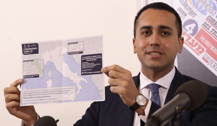 Italian Foreign Minister Luigi di Maio holds up a map of Italy showing the municipalities in regions of Lombardy and Veneto where it is not possible to travel, during a press conference at the foreign press association, in Rome, Thursday, Feb. 27, 2020. The government is seeking to calm fears about the outbreak, which has seen countries issue travel advisories warning their citizens to avoid visiting hard-hit Lombardy and Veneto regions, which have seen the most cases.  (AP Photo/Alessandra Tarantino)
