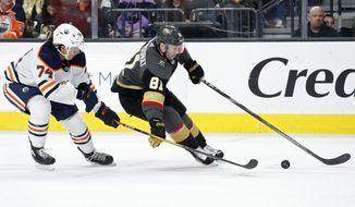 Vegas Golden Knights center Jonathan Marchessault (81) skates around Edmonton Oilers defenseman Ethan Bear (74) during the second period of an NHL hockey game Wednesday, Feb. 26, 2020, in Las Vegas. (AP Photo/John Locher)