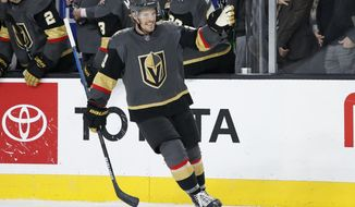 Vegas Golden Knights center Nick Cousins (21) celebrates after scoring against the Edmonton Oilers during the third period of an NHL hockey game Wednesday, Feb. 26, 2020, in Las Vegas. (AP Photo/John Locher)