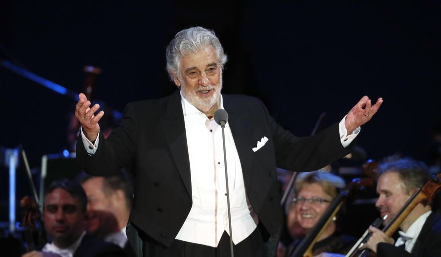 In this Aug. 28, 2019, file photo, opera star Placido Domingo salutes spectators at the end of a concert in Szeged, Hungary. The Spanish government on Wednesday, Feb. 26, 2020, has decided to cancel the participation of tenor Placido Domingo in Madrid's La Zarzuela opera theater in May 2020 in light of the latest developments in the sexual misconduct allegations against the legendary singer. (AP Photo/Laszlo Balogh, File)