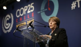 FILE- In this Dec. 9, 2019 file photo, U.N. High Commissioner for Human Rights Michelle Bachelet speaks at the COP25 Climate summit in Madrid, Spain. The United Nations' human rights chief expressed regret Thursday over the Sri Lankan government's decision to withdraw its co-sponsorship of a 2015 resolution backing an investigation of alleged serious human rights violations during the country's civil war. (AP Photo/Andrea Comas, File)