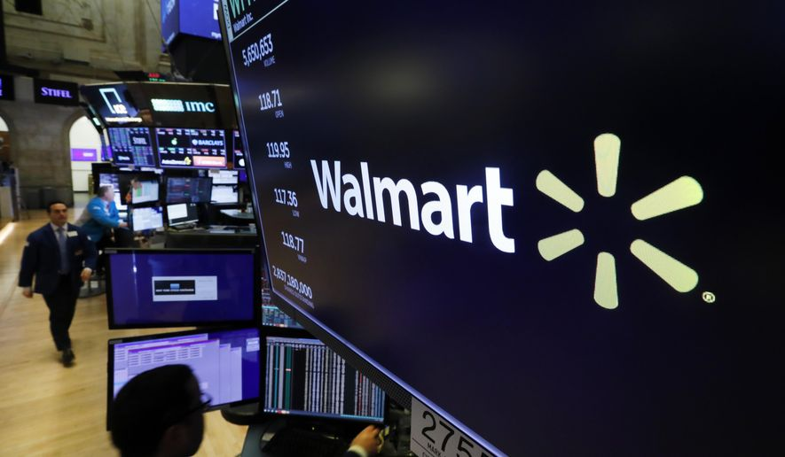 In this Feb. 18, 2020 file photo, the logo for Walmart appears above a trading post on the floor of the New York Stock Exchange. Walmart is confirming that it's developing a competitor to Amazon's juggernaut Prime membership program. The company declined on Thursday, Feb. 27 to offer details, but a spokeswoman said it will be called  Walmart+.   (AP Photo/Richard Drew, File) **FILE**