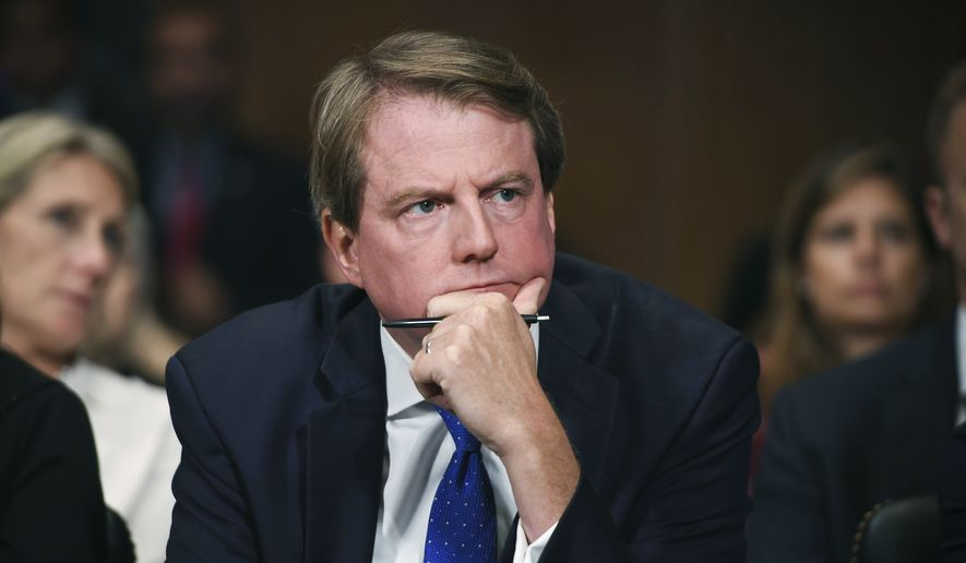 In this Sept. 27, 2018, file photo, then-White House Counsel Don McGahn listens as Supreme court nominee Brett Kavanaugh testifies before the Senate Judiciary Committee on Capitol Hill in Washington. (Saul Loeb/Pool Photo via AP, File)