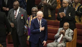FILE - In this Sunday, Feb. 23, 2020 file photo, Democratic presidential candidate former Vice President Joe Biden acknowledges applause from parishioners as he departs after attending services at the Royal Missionary Baptist Church in North Charleston, S.C. His campaign hired a South Carolina faith outreach director in August 2019 and announced the endorsement of 100 local faith leaders in December. (AP Photo/Matt Rourke)