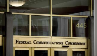This June 19, 2015, file photo, shows the Federal Communications Commission building in Washington. (AP Photo/Andrew Harnik, File)