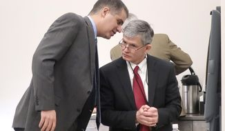 """FILE - In this Dec. 12, 2019 file photo, District Judge F. William Cullins, right, of Montgomery County, Kansas, confers with his attorney, Christopher Joseph, during a break in his disciplinary hearing, in Topeka, Kansas. The foul-mouthed Kansas judge who cursed at courthouse employees so often that a trial clerk kept a """"swear journal"""" documenting his obscene outbursts should be publicly censured and receive professional coaching, but his removal from the bench is not warranted, a disciplinary panel recommended Friday, Feb. 28, 2020. The findings by the Kansas Commission on Judicial Conduct on Montgomery County Judge F. William Cullins will be sent to the Kansas Supreme Court for a final decision. (AP Photo/John Hanna, File)"""