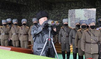 "In this Friday, Feb. 28, 2020, photo provided Saturday, Feb. 29, 2020, by the North Korean government, North Korean leader Kim Jong Un, center, inspects the military drill of units of the Korean People's Army, with soldiers shown wearing face masks. Independent journalists were not given access to cover the event depicted in this image distributed by the North Korean government. The content of this image is as provided and cannot be independently verified. Korean language watermark on image as provided by source reads: ""KCNA"" which is the abbreviation for Korean Central News Agency. (Korean Central News Agency/Korea News Service via AP)"