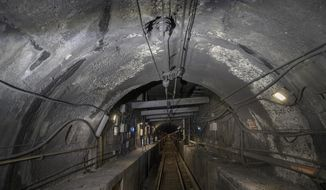 FILE - This Oct. 17, 2018 file photo shows damage to the Hudson River rail tunnel in New York. The news that Amtrak is working with federal officials to do extensive repairs to its Hudson River rail tunnel while a plan to build a new tunnel languishes raises the specter of more delays for already beleaguered commuters.  Transportation Secretary Elaine Chao told a House subcommittee Thursday, Feb. 27, 2020,  that the work needs to happen now instead of waiting for a new tunnel to be built, (Pool Photo/Victor J. Blue/The New York Times via AP)
