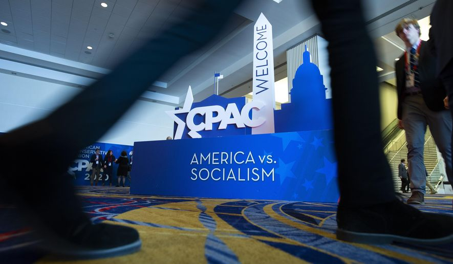 People pass by the CPAC sign during Conservative Political Action Conference, CPAC 2020, at the National Harbor, in Oxon Hill, Md., Friday, Feb. 28, 2020. (AP Photo/Jose Luis Magana) **FILE**