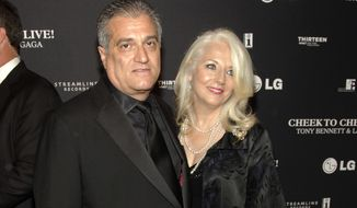 This July 28, 2014, photo shows Joe Germanotta, left, and Cynthia Germanotta at a Tony Bennett and Lady Gaga concert taping in New York. Joe Germanotta, father of singer-actress Lady Gaga, is refusing to pay $260,000 in rent and fees for his restaurant at New York City's Grand Central Terminal, saying the homeless population is hurting his business. Owner of Art Bird & Whiskey Bar, Germanotta said he wants the Metropolitan Transit Authority, which oversees the busy commuter train station, to renegotiate his rent or release him from his lease, which expires in 2028. (Photo by Andy Kropa/Invision/AP) **FILE**