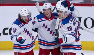 New York Rangers' Ryan Strome, center, celebrates his goal against the Montreal Canadiens with teammates Artemi Panarin, left, and Chris Kreider during the third period of an NHL hockey game Thursday, Feb. 27, 2020, in Montreal. (Paul Chiasson/The Canadian Press via AP)