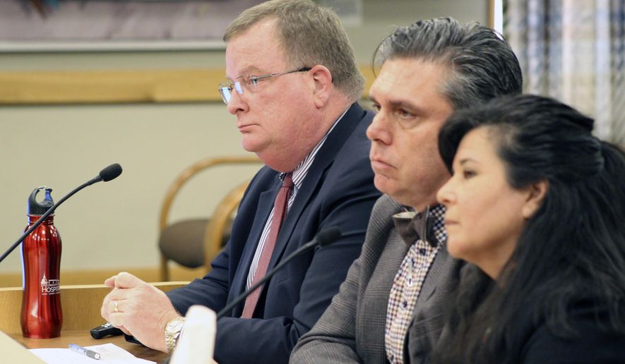 Three officials of the Oregon Health Authority testified on Friday, Feb. 28, 2020, before a committee of the Oregon Legislature in Salem, on preparations for a possible outbreak of coronavirus in Oregon. Appearing before the House Committee on Health Care were, from left, OHA Director Patrick Allen, Dean Sidelinger, state health officer and state epidemiologist, and Akiko Saito, section manager of health security, preparedness and response. (AP Photo/Andrew Selsky)