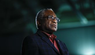 Rep. James Clyburn, D-S.C. listens to Democratic presidential candidate former Vice President Joe Biden speak at a primary night election rally in Columbia, S.C., Saturday, Feb. 29, 2020. (AP Photo/Matt Rourke)