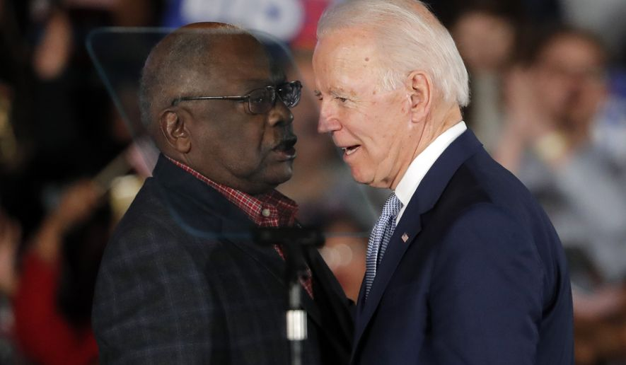 Democratic presidential candidate former Vice President Joe Biden talks to Rep. James Clyburn, D-S.C., at a primary night election rally in Columbia, S.C., Saturday, Feb. 29, 2020 after winning the South Carolina primary. (AP Photo/Gerald Herbert)