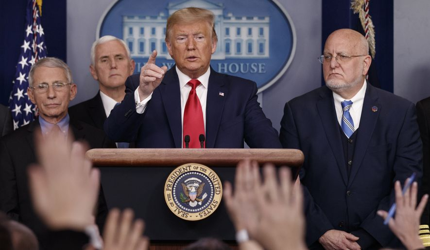 President Donald Trump points as he prepares to answer question after speaking about the coronavirus in the press briefing room at the White House, Saturday, Feb. 29, 2020, in Washington, as, National Institute for Allergy and Infectious Diseases Director Dr. Anthony Fauci, Vice President Mike Pence, and Robert Redfield, director of the Centers for Disease Control and Prevention, listen. (AP Photo/Carolyn Kaster)