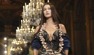Model Bella Hadid wears a creation for the Vivienne Westwood fashion collection during Women's fashion week Fall/Winter 2020/21 presented in Paris, Saturday, Feb. 29, 2020. (Photo by Vianney Le Caer/Invision/AP)