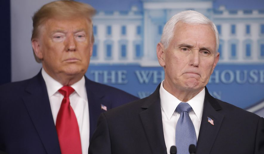 President Donald Trump, left, listens to Vice President Mike Pence, right, as he pauses while speaking to members of the media to address the nation about the coronavirus threat in the Brady Press Briefing room of the White House in Washington, Saturday, Feb. 29, 2020. (AP Photo/Carolyn Kaster)
