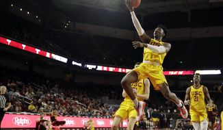 Southern California guard Jonah Mathews drives to the basket during the first half of an NCAA college basketball game against Arizona State Saturday, Feb. 29, 2020, in Los Angeles. (AP Photo/Marcio Jose Sanchez)