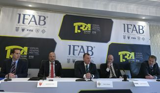 From left, English Football Association chief executive Mark Bullingham, Football Association of Wales chief executive Jonathan Ford, Irish Football Association chief executive Patrick Nelson, FIFA President Gianni Infantino, Scottish Football Association chief executive Ian Maxwell attend a press conference in Holywood, Northern Ireland, Saturday, Feb. 29, 2020. Changes to the offside law are coming to soccer that will aim to give the benefit of the doubt to attacking players when goal decisions are reviewed by video replays. A law designed to stop goal-hanging will be subject to a global consultation that was approved Saturday by the International Football Association Board with the intention of giving an edge to attackers. (AP Photo/Rob Harris)
