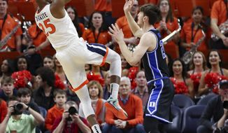 Virginia forward Mamadi Diakite (25) shoots over Duke forward Matthew Hurt (21) during an NCAA college basketball game Saturday, Feb. 29, 2020, in Charlottesville, Va. (AP Photo/Andrew Shurtleff)