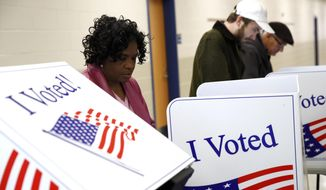 Voters fill out their ballots at a primary polling place, Saturday, Feb. 29, 2020, in Charleston, S.C. (AP Photo/Patrick Semansky)