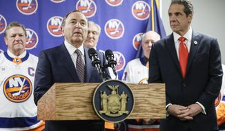 NHL commissioner Gary Bettman, left, speaks alongside New York Governor Andrew Cuomo, right, during a news conference before an NHL hockey game between the Boston Bruins and New York Islanders, Saturday, Feb. 29, 2020, in Uniondale, NY. (AP Photo/John Minchillo)