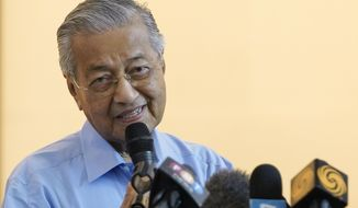 Malaysia's interim leader Mahathir Mohamad speaks during a press conference after Muhyiddin Yassin was appointed as new prime minister in Kuala Lumpur, Sunday, March 1, 2020. Malaysia's king on Saturday appointed seasoned politician Muhyiddin as the country's new leader, trumping Mahathir's bid to return to power after a week of political turmoil that followed his resignation as prime minister. (AP Photo/Vincent Thian)