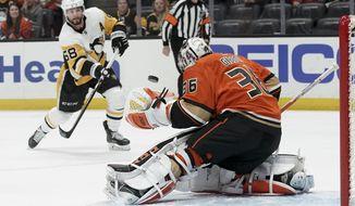 Anaheim Ducks goaltender John Gibson blocks a shot by Pittsburgh Penguins defenseman Kris Letang during the first period of an NHL hockey game in Anaheim, Calif., Friday, Feb. 28, 2020. (AP Photo/Chris Carlson)
