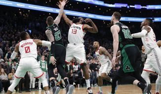 Boston Celtics' Daniel Theis (27) and Houston Rockets' James Harden (13) battle for the rebound on a missed shot by Jaylen Brown as time runs out in overtime during an NBA basketball game in Boston, Saturday, Feb. 29, 2020. The Rockets won 111-110.(AP Photo/Michael Dwyer)