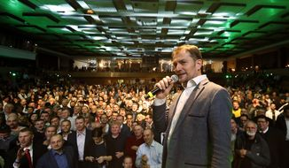 Leader of the Ordinary People and Independent Personalities party Igor Matovic addresses his supporters, acknowledging preliminary results of the general election in Trnava, Slovakia, Sunday, March 1, 2020. (AP Photo/Petr David Josek)