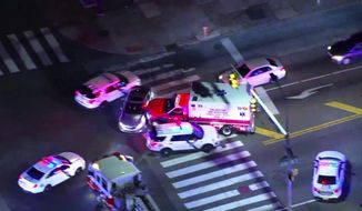 In this image made from video provided by NBC10 Philadelphia, a stolen ambulance collides with a vehicle before police officers capture a man driving the ambulance in Philadelphia on Friday, Feb. 28, 2020. The man stole the ambulance and tried to run over an officer who shot him three times, leading to a low-speed chase through Philadelphia that lasted more than an hour Friday night, authorities said. (NBC10 Philadelphia via AP) ** FILE **