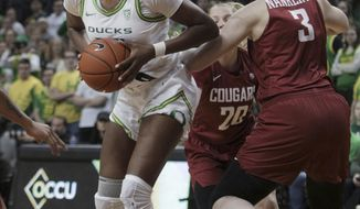 Oregon's Ruthy Hebard, left, moves around Washington State's Emma Nankervis, right, during the first half of an NCAA college basketball game in Eugene, Ore., Friday, Feb. 28, 2020. (AP Photo/Collin Andrew)