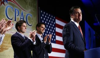 Republican presidential candidate, former Massachusetts Gov. Mitt Romney is applauded by sons Josh, center, and Tagg, left, as he speaks at a Colorado Conservative Political Action Committee (CPAC) meeting in Denver, Thursday, Oct. 4, 2012. (AP Photo/Charles Dharapak)