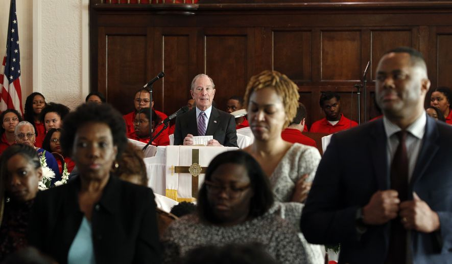 Members turn their backs on Mayor Michael Bloomberg as he speaks at Brown Chapel AME church in protest Sunday, March 1, 2020, in Selma , Ala. (AP Photo/Butch Dill)