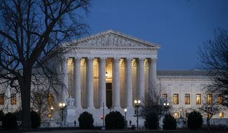 In this Jan. 22, 2020, file photo, Night falls on the Supreme Court in Washington. (AP Photo/J. Scott Applewhite, File)
