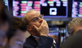 Trader David O'Day works on the floor of the New York Stock Exchange, Friday, Feb. 28, 2020. Stocks sank again after another wild day, extending a rout that left Wall Street with its worst week since October 2008. (AP Photo/Richard Drew)