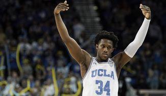 UCLA guard David Singleton celebrates during the second half of an NCAA college basketball game against Arizona in Los Angeles, Saturday, Feb. 29, 2020. UCLA won 69-64. (AP Photo/Chris Carlson)