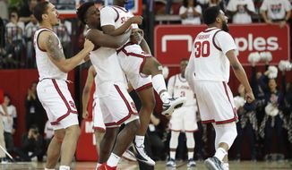 St. John's forward Marcellus Earlington, second from left, lifts St. John's guard Greg Williams Jr. (4) in the air after Williams hit a three-point basketball as they celebrate during the second half of an NCAA college basketball game against Creighton, Sunday, March 1, 2020, in New York. (AP Photo/Kathy Willens)