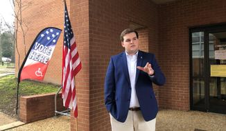 University of Memphis student Landon Shelby speaks with a reporter outside an off-campus voting location on Tuesday, Feb. 25, 2020, in Memphis, Tenn. Shelby, a Republican, said he would like to see the university have a polling location on campus to help students cast ballots more easily. (AP Photo/Adrian Sainz)