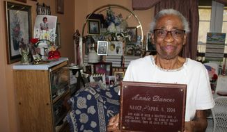 Annie Dancer, 89, holds up a plaque she received in 1994 from the Oktibbeha County NAACP, of which she is a lifelong member, in her house on Saturday, Feb. 22, 2020. Dancer was an active participant in the Civil Rights Movement of the 1960s and marched in Washington D.C. with fellow Oktibbeha County NAACP members. She continues to march in Starkville's annual Martin Luther King Jr. Day march. (Tess Vrbin/The Commercial Dispatch via AP)