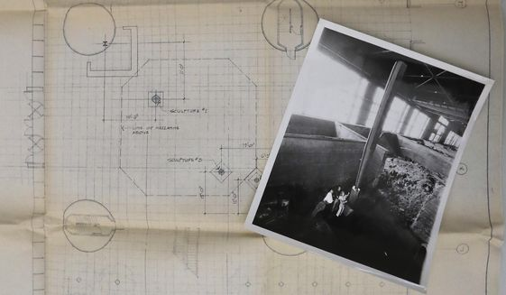 This Feb. 11, 2020, photo shows drawings for the placement of sculptures created by Beverly Pepper in 1981 at the John Deere Foundry in Moline, Ill. (Kevin E. Schmidt/Quad City Times via AP)