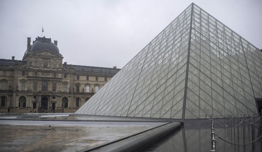 A view of the Louvre museum, in Paris, France, Sunday, March 1, 2020. The spreading coronavirus epidemic shut down France's Louvre Museum on Sunday, with workers who guard its trove of artworks fearful of being contaminated by the museum's flow of visitors from around the world. (AP Photo/Rafael Yaghobzadeh)